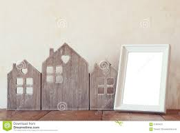 image of vintage wooden house decor blank frame on wooden table