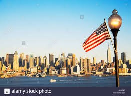 New Yorks Flag New York City Skyline And American Flag Stock Photo Royalty Free