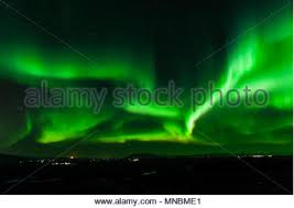 northern lights iceland april strong bright green aurora northern lights over mountain tromso