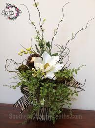 silk flower arrangement with burlap covered jar and burlap zebra