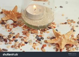 tea light candle jar sea sand stock photo 345899345 shutterstock
