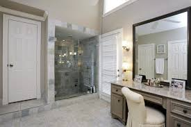 bathroom bathroom with shower and makeup table with white chair