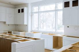 installing a kitchen base cabinet stock photo wooden cabinets installation of in the white of installation base cabinets modular kitchen