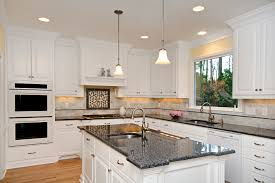 White Kitchen Countertop Ideas by Pictures Of A Kitchen With White Cabinets And White Granite One Of