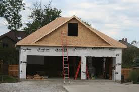 3 Door Garage by Nest Homes Construction North Royalton 3 Car Garage With 2nd
