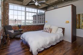 closet behind bed closet behind bed with exposed brick bedroom industrial and blade