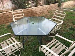 hexagon patio table and chairs hexagon patio table and 4 chairs used but in very good condition