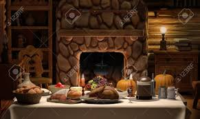 a thanksgiving dinner on a table set in cozy cabin stock photo