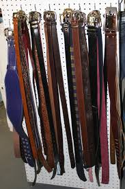 used clothing stores belts hanging on display at used clothing store picture free