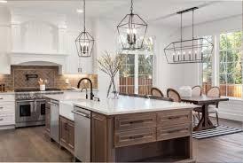 kitchen island cabinet design popular kitchen island trends designers are incorporating