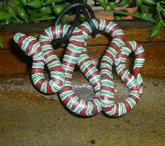 striped tree snake ornament by carawaycreek