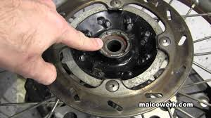 removing the honda wheel bearing retainer cr250 cr500 youtube