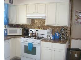 interior small kitchen design with white timberlake cabinets and