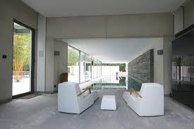 the white pool house slim frame sliding glass doors minimal