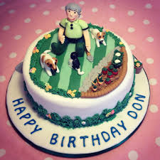 birthday cake with a garden theme handmade dogs and a cat made