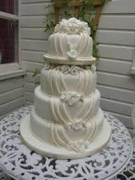 4 tier stacked roses u0026 drapes wedding cake cinnamon square