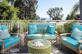 teak outdoor furniture with turquoise cushions cottage deck patio
