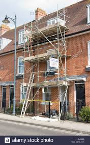 scaffold scaffolding painting and decorating on small modern house