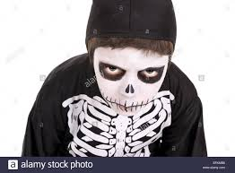 Halloween Costumes Skeleton Boy by Boy With Face Paint And Skeleton Halloween Costume Isolated In