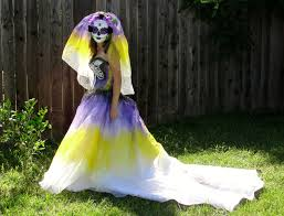 purple and yollow skeleton day of the dead costume with