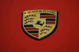 porsche logo file porsche emblem on a red porsche jpg wikimedia commons