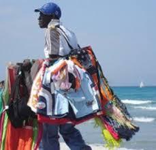 venditore di tappeti commercio abusivo in spiaggia multa per 19 venditori alghero eco