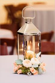 candle centerpiece and grey wedding wedding tablescape candle lit lantern