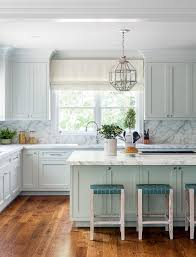 white kitchen cabinets with blue island lanterns light blue island transitional kitchen