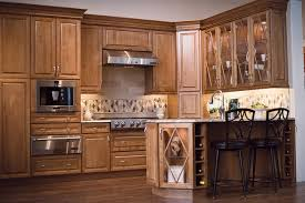 Kraftmaid Kitchen Cabinets by Praline Maple Cabinets Are Highlighted By Glass Doors And Wine