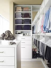 small closet design with shoes and clothes storage in white wooden