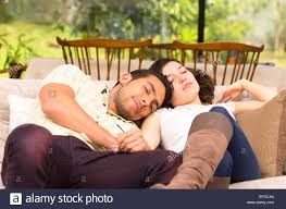Sleeping On The Sofa Cute Couple Lying Resting Sleeping On The Sofa Stock Photo