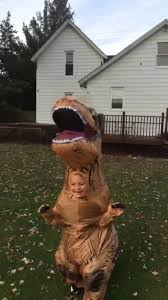 kid in t rex costume chases original