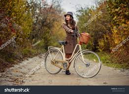 bicycle coat beautiful brown autumn coat hat stock photo 501084145