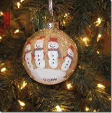 handprint snowmen on clear ornaments then fill them with tinsel so