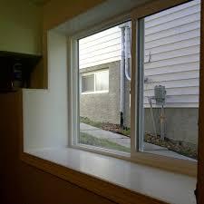 egress basement window installation marcotte glass calgary