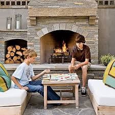 Stacked Stone Outdoor Fireplace - 15 outdoor fireplace design ideas coastal living