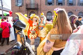 picture of heavy set women in a two piece bathing suit two heavy set women in costume at mardi gras parade making kissey