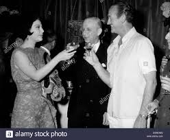 actor david niven at a cocktail party for the film u0027the captive
