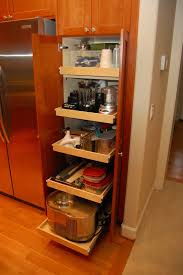 natty cherry wood pantry cabinet in minimalist corner kitchen