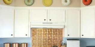 how to decorate space above kitchen cabinets are you tired of an empty space above your kitchen
