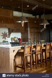 bar stools at breakfast bar in country style kitchen usa stock