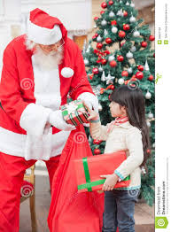 santa claus giving gifts to stock images image 36831194