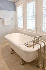 vintage tub tile shower with bench dark cabinets with white