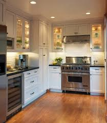 white cabinets black countertop kitchen traditional with