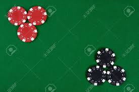 Table Top Poker Table Two Kinds Of Poker Chips In Two Corners Of A Green Poker Table