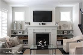 interior small living room with tv over fireplace living room