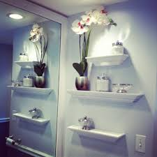 Bathroom Wall Shelving Ideas Stunning Statue Above Wooden Shelves At Bathroom Using Traditional