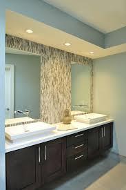 dark floating mirror bathroom on light blue wall with backsplash