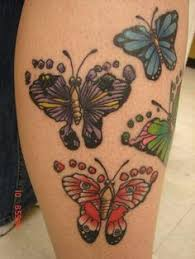 butterfly tattoo with baby footprint butterfly tattoo with my children s footprint from birth and their