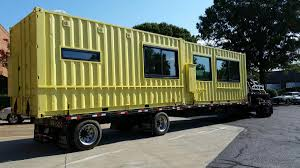 innovation and design building is installing shipping container kiosks